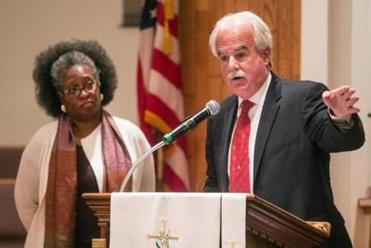 10/19/2015 LYNN, MA Lynn Police Chief Kevin Coppinger (cq) (right) speaks beside Rev. Viola Buchanan (cq) during a meeting between the Lynn Police Department and residents held at Zion Baptist Church in Lynn sponsored by the Essex County Community Organization (ECCO). (Aram Boghosian for The Boston Globe)
